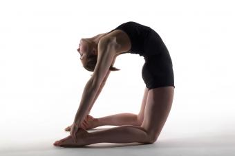 Woman in camel pose, isolated