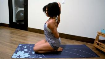 Woman doing yoga to relieve shoulder pain