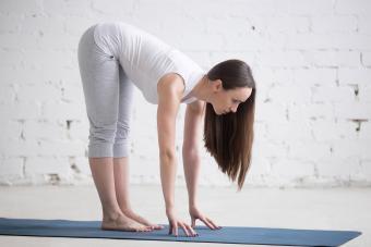 Yoga woman in forward bend