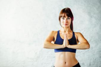 Woman in yoga prayer position