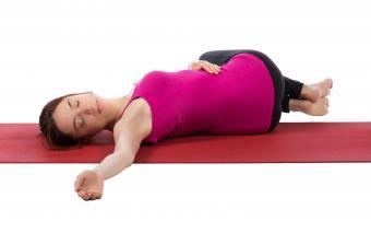 woman doing yoga spinal twist