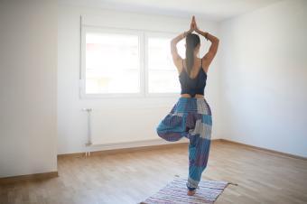 woman doing tree yoga pose