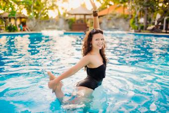 Doing yoga in swimming pool