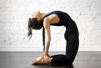 Woman practicing yoga, stretching in Ustrasana exercise, Camel pose