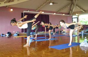 Moreno leading a yoga class through Warrior III.