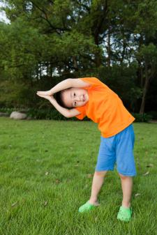 Boy doing crescent pose