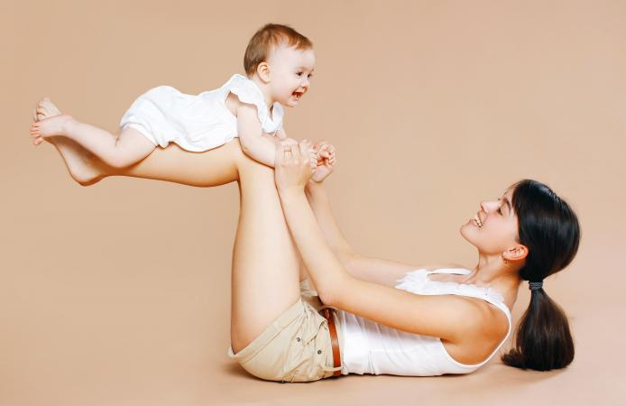 Mother holding baby exercise