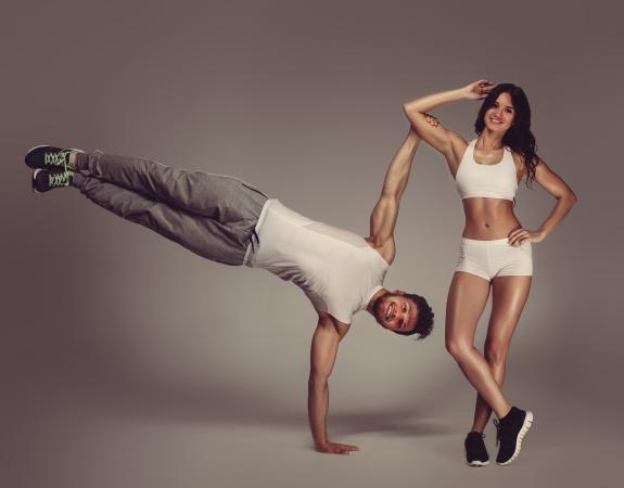 Athletic Couple Practicing yoga