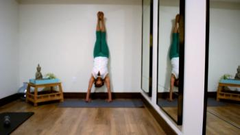 Woman achieving a full handstand