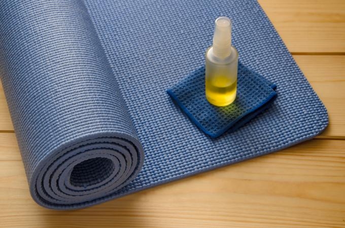 blue yoga mat with cleaner