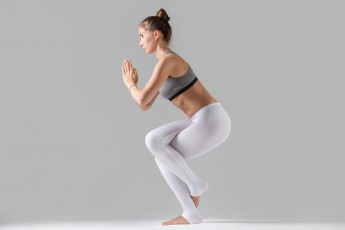 Woman holding Eagle Pose