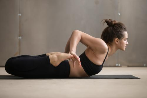 Woman holding Frog Pose