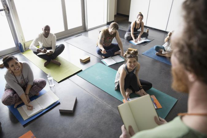 students on yoga mats