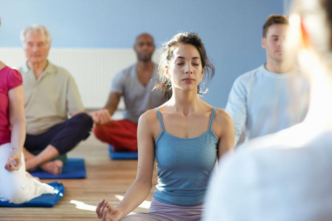 Woman in class practicing meditation