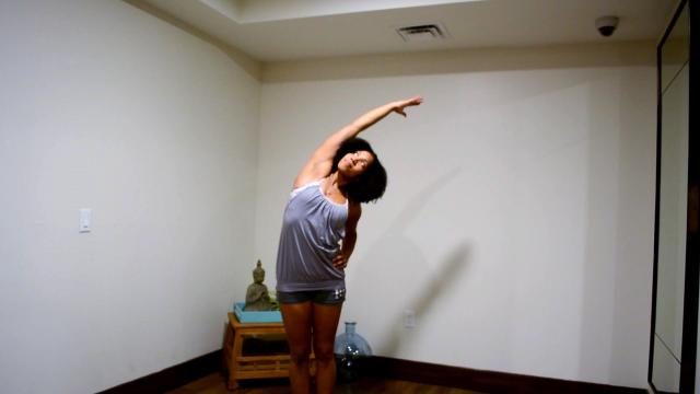 Woman performing a standing side bend