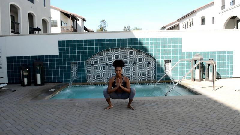 Image of woman in basic yoga squat