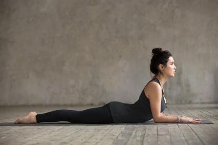 woman doing yoga sphinx pose