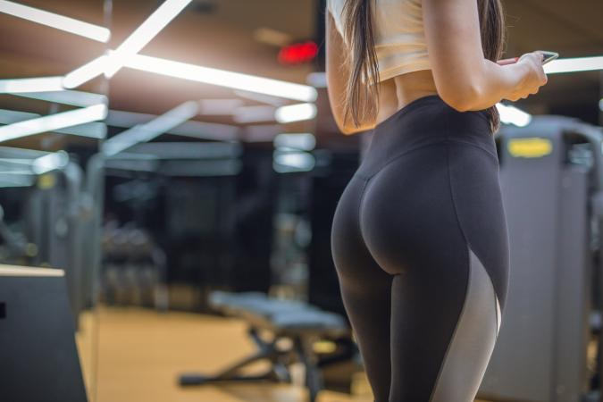 female in gym wearing yoga pants