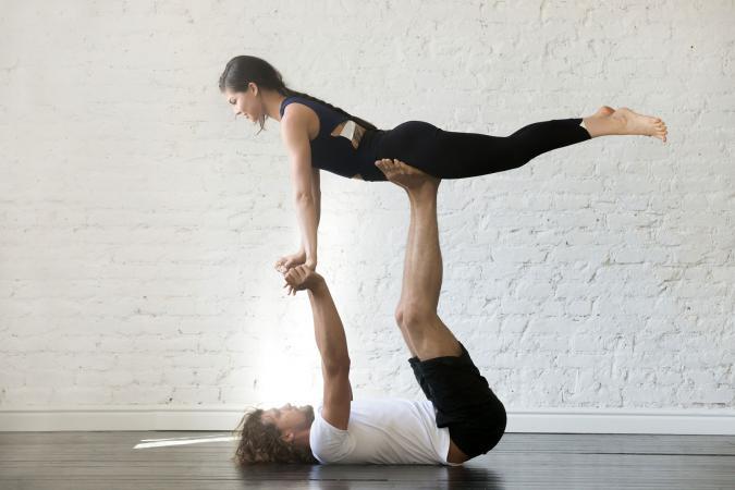 Couple doing acrobatic yoga pose