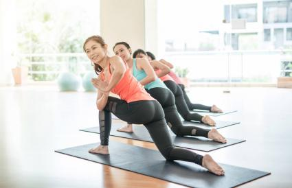 Women Exercising In Health Club