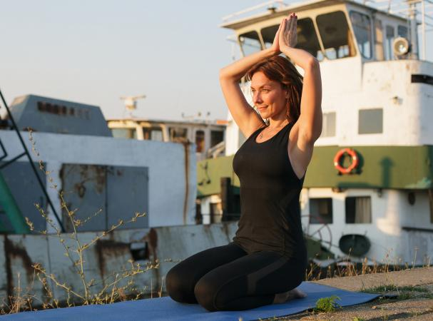 woman doing hero yoga pose